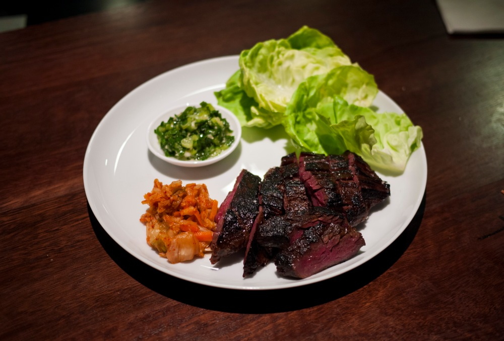 Marinated hanger steak ssam with ginger scallion, kimchi, bibb lettuce